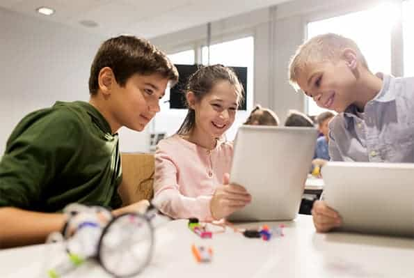 children looking at electronics
